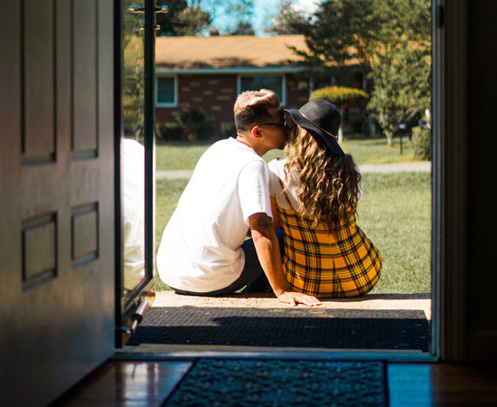 couple sitting outside on a front porch